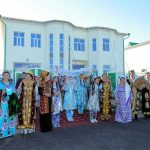 Citizens of Turkmenistan in ethnic Turkmen and Uzbek dresses - 17 June 2016 - Dashoguz