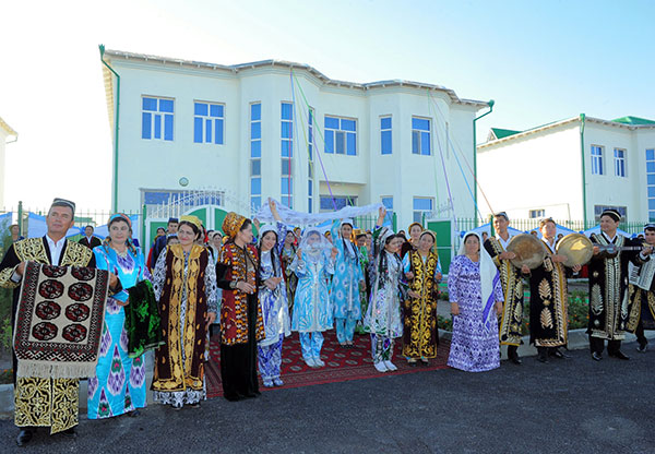 Citizens of Turkmenistan in their ethnic Turkmen and Uzbek dresses - 17 June 2016 - Dashoguz